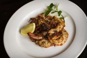 Spicy king prawns, onion, shallots and crispy basil